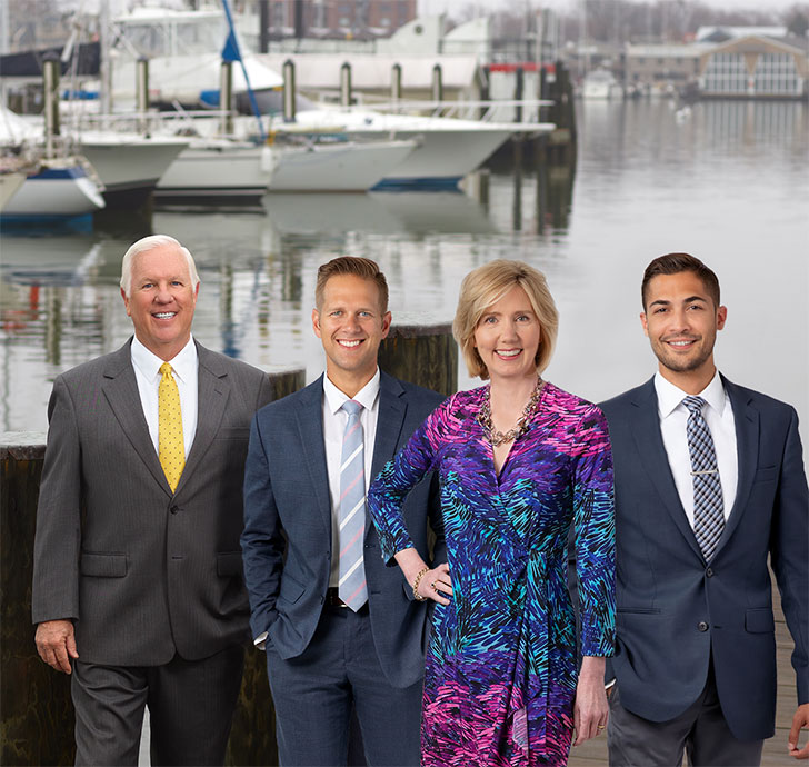 Mr. Waterfront team standing on dock